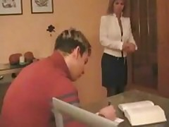Sexy blonde Russian mother helping her stepson