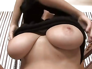 Playing with mom's natural tits
