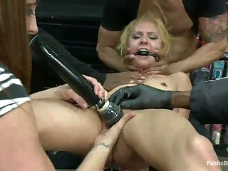 Tiny blonde fucked in sleazy sex shop