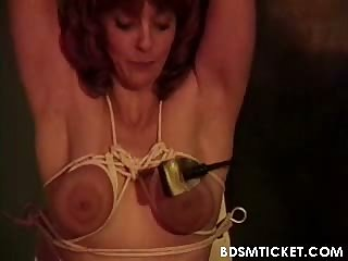 Lady is titty tortured by rope