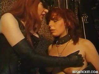 Busty redhead slave
