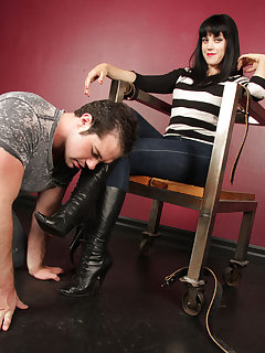 12 of Mistress O sits dominantly and gets her boots worshipped
