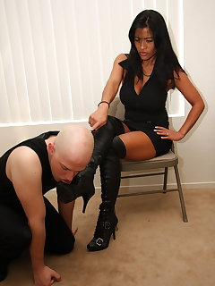 12 of Tia dominates slave with her boots