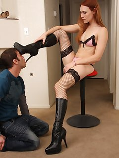 <!–-IMAGE_COUNT-–> of Jolene sits on the stool and dominates her slave