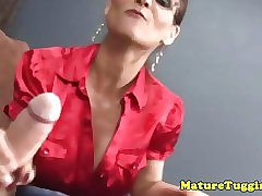 Amateur cougar tugs on a big pink willie